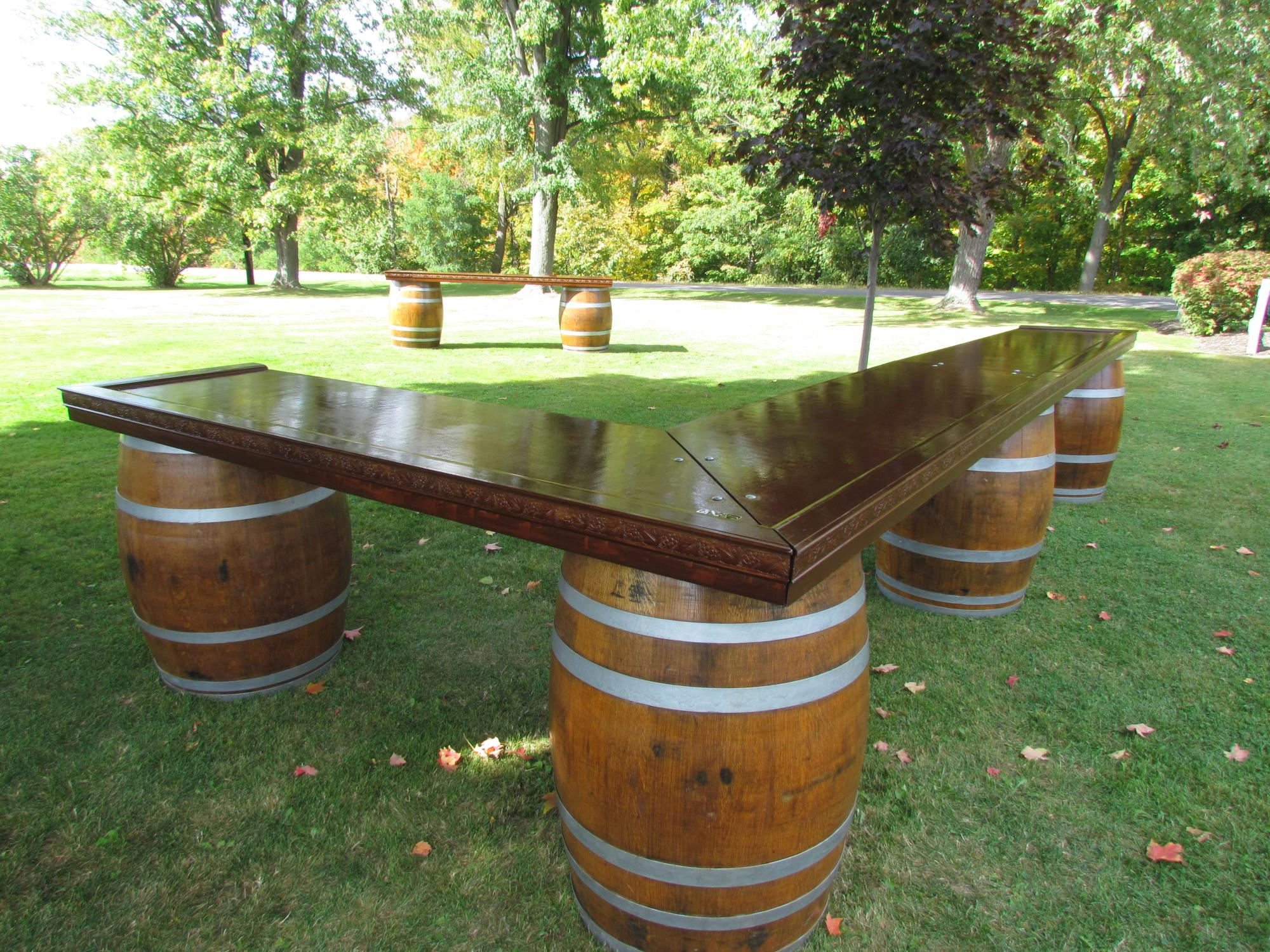 4 barrel Chardonnay- refinished oak wine barrels as the base- 2 barrel Riesling in the background